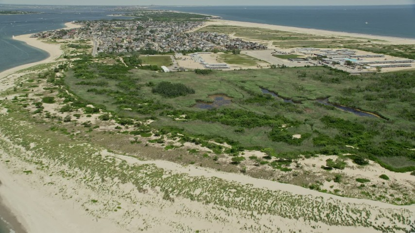 5K aerial video flying over the Breezy Point Surf Club, Queens, New York Aerial Stock Footage | AX83_223