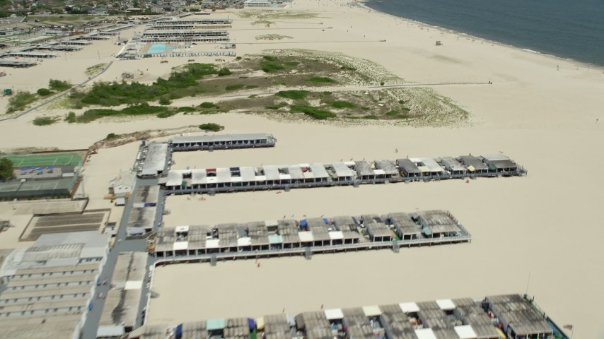 5K stock footage aerial video flying over sunbathers by Catalina Beach Club in Atlantic Beach, Long Island, New York Aerial Stock Footage | AX83_234