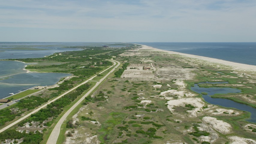 5K stock footage aerial video following coastal roads in Jones Beach State Park, Wantagh, New York Aerial Stock Footage | AX83_250