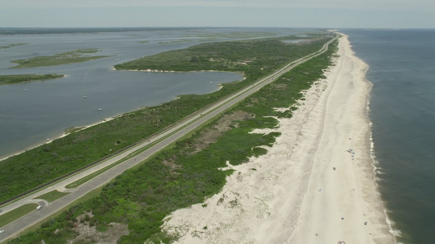 5K stock footage aerial video flying by Light Traffic on Ocean Parkway, Wantagh, New York Aerial Stock Footage | AX83_254