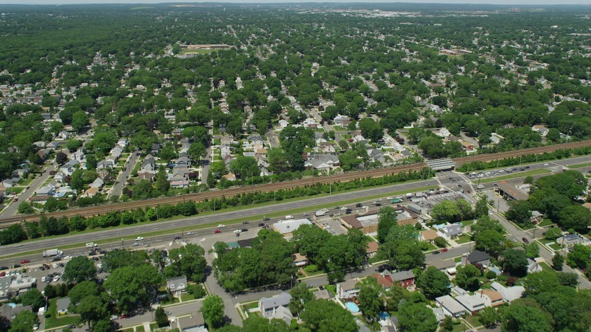 5K stock footage aerial video flying over State Route 27 and suburban neighborhoods in Massapequa Park, New York Aerial Stock Footage | AX83_262