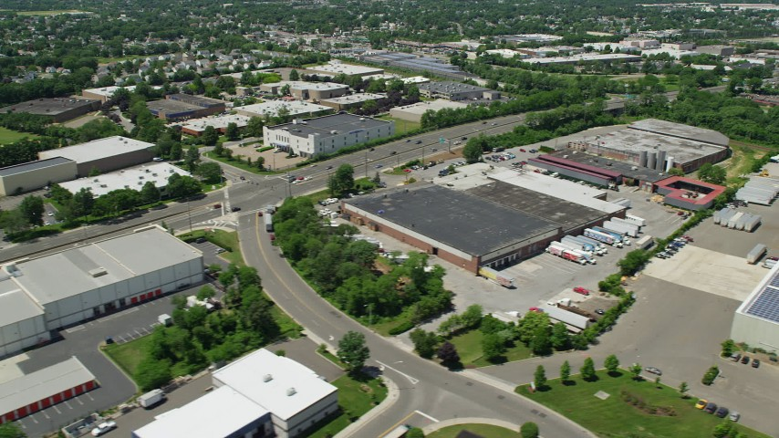 5K stock footage aerial video flying by warehouse buildings on Broad Hollow Road in Farmingdale, New York Aerial Stock Footage | AX83_266