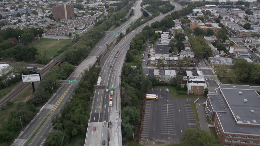 4K stock footage aerial video Flying over Jersey Turnpike, tilt up, Jersey City, New Jersey Aerial Stock Footage | AX84_001