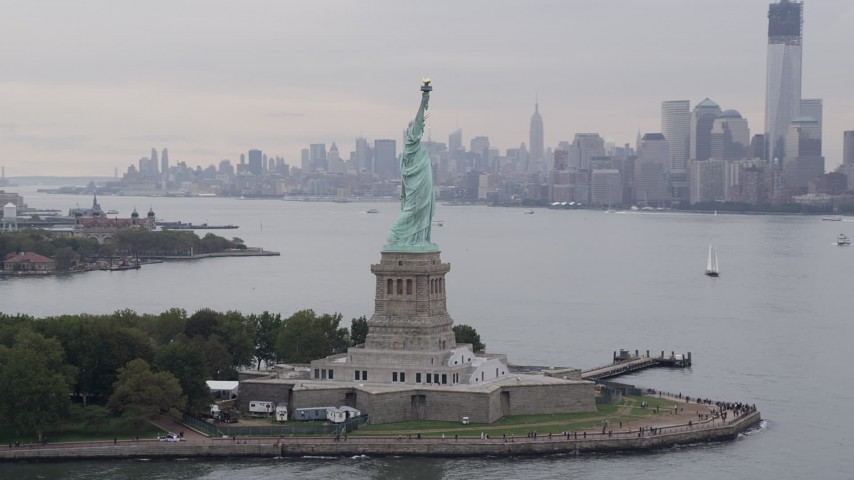 4K aerial video Flying by the Statue of Liberty, New York, New York Aerial Stock Footage | AX84_004