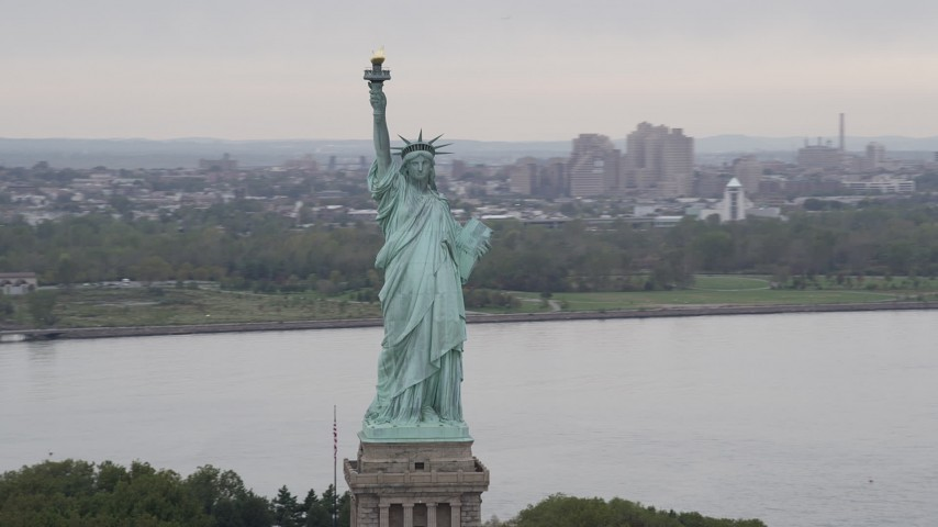 4K stock footage aerial video Flying by the Statue of Liberty, New York, New York Aerial Stock Footage | AX84_005