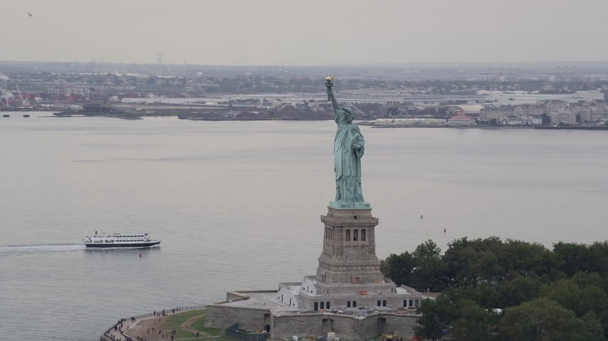 4K stock footage aerial video Flying by the Statue of Liberty, New York, New York Aerial Stock Footage | AX84_007