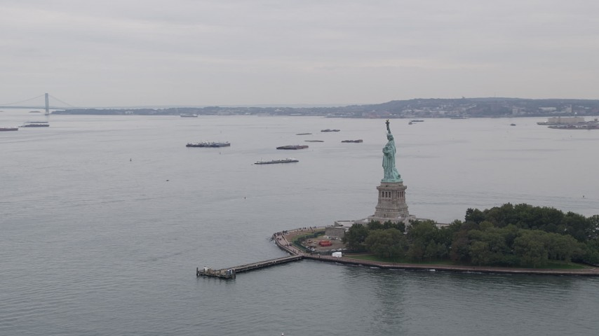 4K stock footage aerial video Flying by Statue of Liberty, reveal Verranzano-Narrows Bridge, New York, New York Aerial Stock Footage | AX84_008