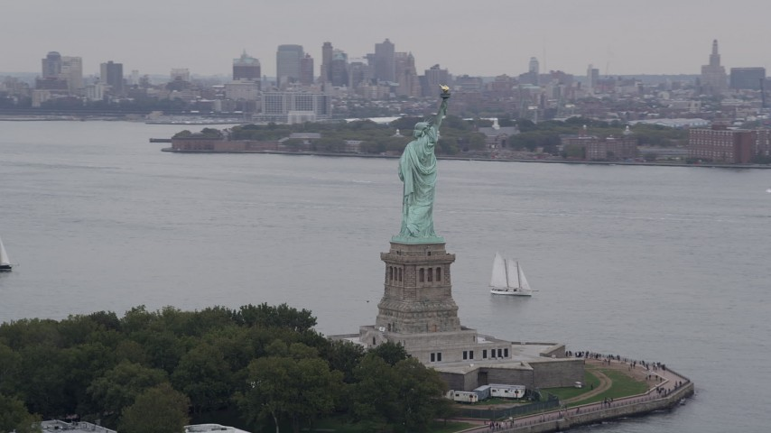 4K stock footage aerial video Flying by the Statue of Liberty, New York, New York Aerial Stock Footage | AX84_012