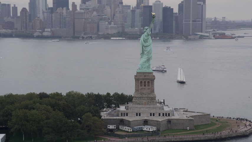 4K stock footage aerial video Flying by the Statue of Liberty, New York, New York Aerial Stock Footage | AX84_013