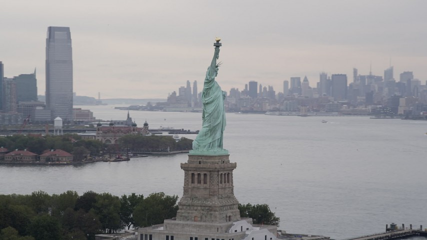 4K stock footage aerial video Orbiting the Statue of Liberty, New York, New York Aerial Stock Footage | AX84_014