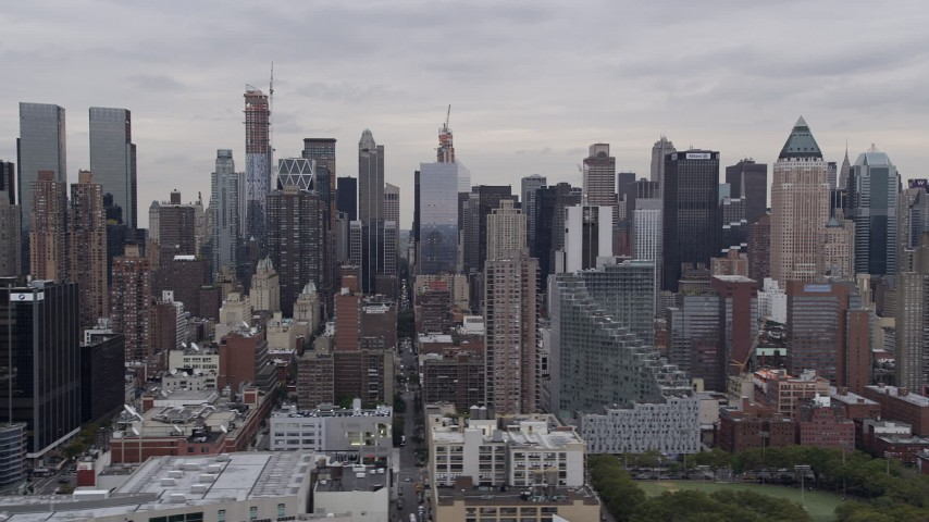 4K aerial video Flying by Midtown Manhattan skyscrapers, from Hudson River, New York, New York Aerial Stock Footage | AX84_025