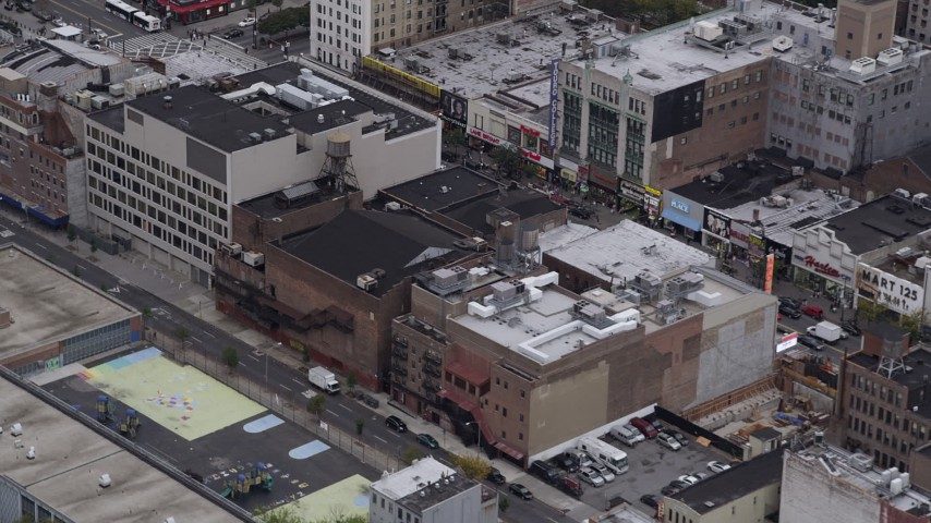 4K stock footage aerial video Flying over shops in Harlem, New York, New York Aerial Stock Footage | AX84_038
