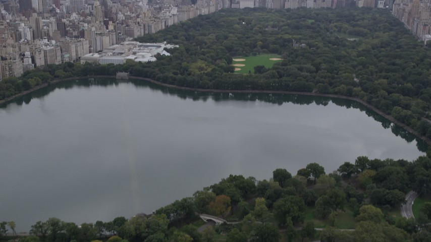 4K stock footage aerial video Flying over Central Park, revealing Midtown Manhattan, New York, New York Aerial Stock Footage | AX84_042