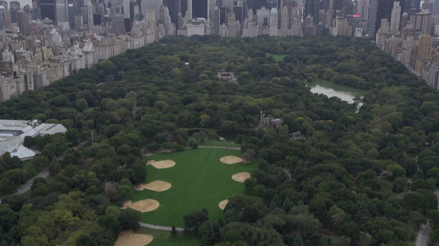 4K stock footage aerial video Flying over Central Park, revealing Midtown Manhattan, New York, New York Aerial Stock Footage | AX84_043
