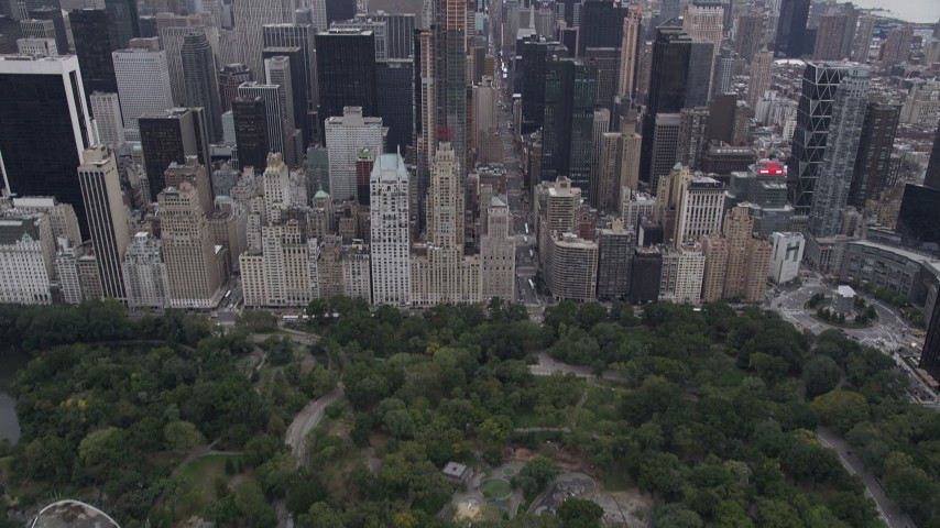 4K aerial video Tilting up revealing Midtown Manhattan, from Central Park, New York, New York Aerial Stock Footage | AX84_047