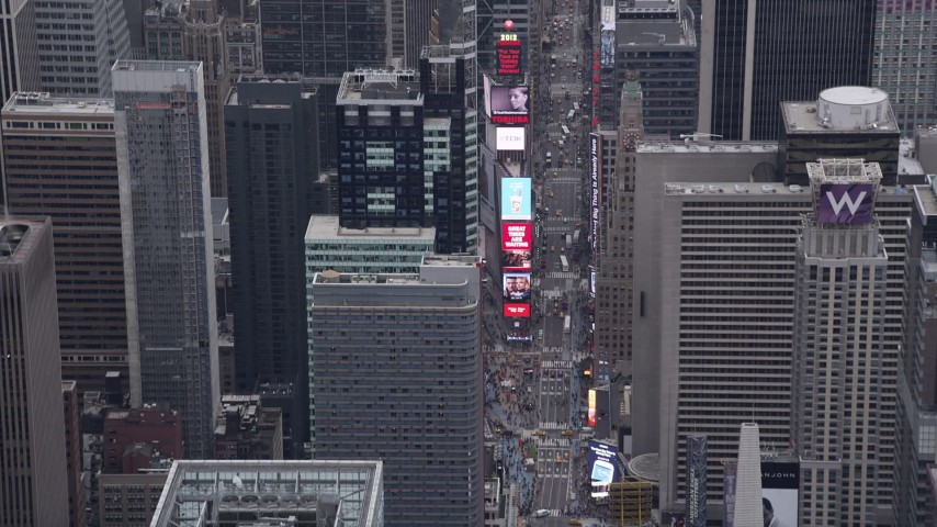 4K stock footage aerial video of 7th Avenue, Times Square, Midtown Manhattan, New York, New York Aerial Stock Footage | AX84_049