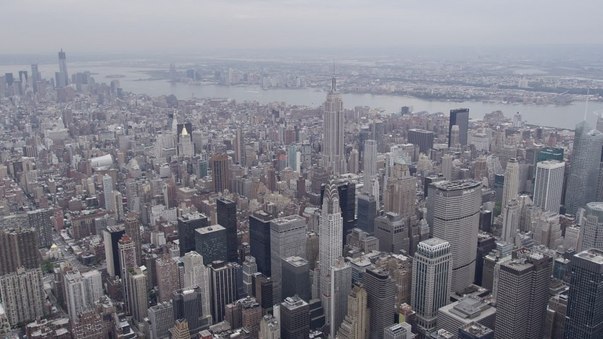 4K stock footage aerial video Approaching Chrysler Building, Empire State Building, New York, New York Aerial Stock Footage | AX84_071