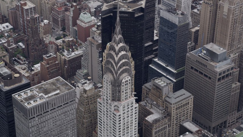 4K stock footage aerial video Approaching the top of the Chrysler Building, Midtown Manhattan, New York, New York Aerial Stock Footage | AX84_072