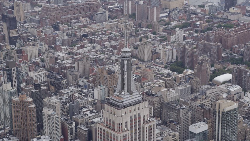 4K aerial video Approaching top of Empire State Building, Midtown Manhattan, New York, New York Aerial Stock Footage | AX84_074