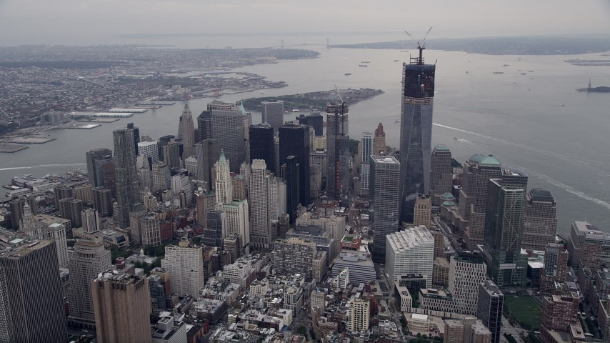 4K stock footage aerial video Approaching Lower Manhattan, pan right to Freedom Tower, New York, New York Aerial Stock Footage | AX84_082