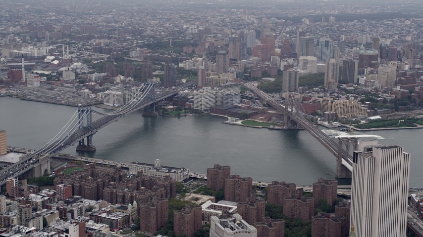 4K stock footage aerial video Flying by Manhattan Bridge, Brooklyn Bridge, East River, New York, New York Aerial Stock Footage | AX84_093
