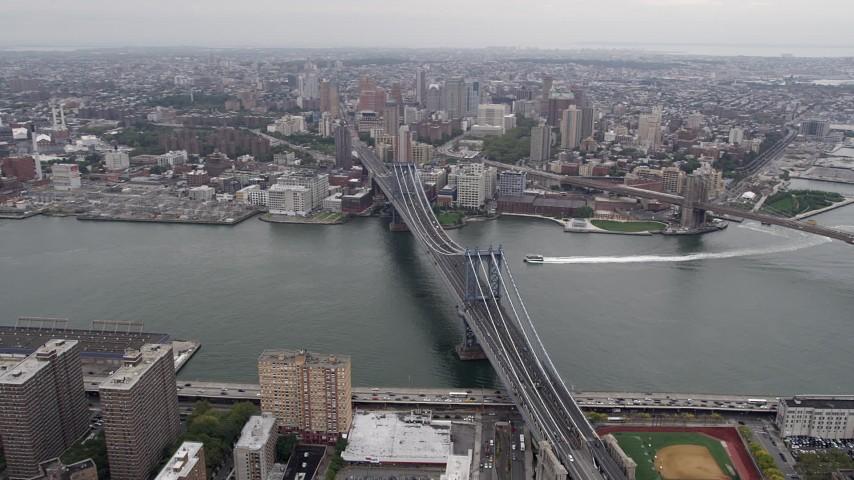4K stock footage aerial video Flying by Manhattan Bridge, East River, Lower Manhattan, New York, New York Aerial Stock Footage | AX84_096