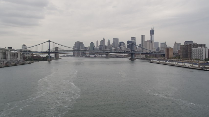 4K stock footage aerial video Approaching Manhattan Bridge, Lower Manhattan skyline, New York, New York Aerial Stock Footage | AX84_103
