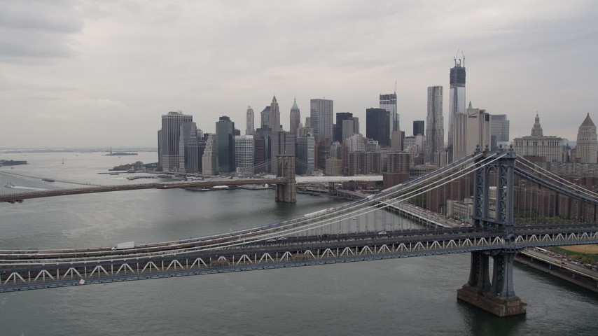 4K stock footage aerial video of Manhattan Bridge, Lower Manhattan skyline, Brooklyn Bridge, New York Aerial Stock Footage | AX84_104