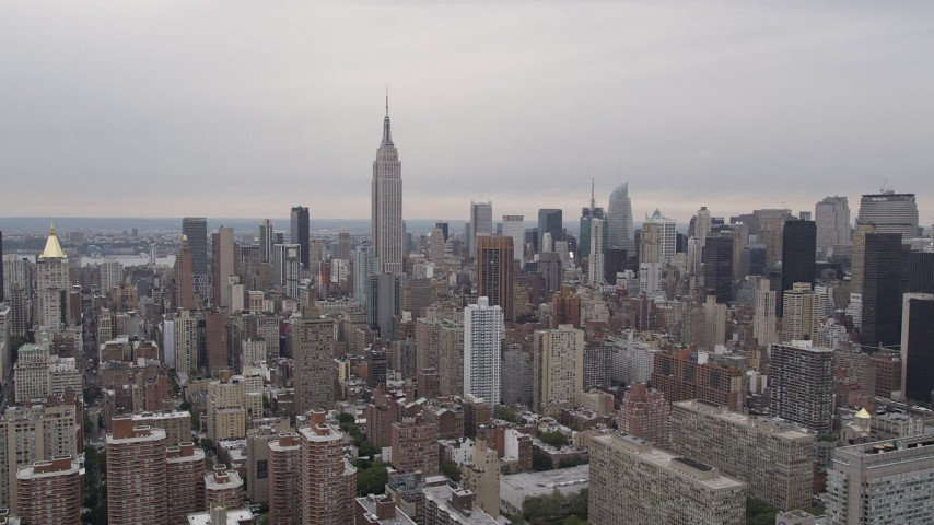 4K Aerial Video Fly by Empire State Building, Midtown Manhattan skyscrapers, New York, New York Aerial Stock Footage | AX84_135