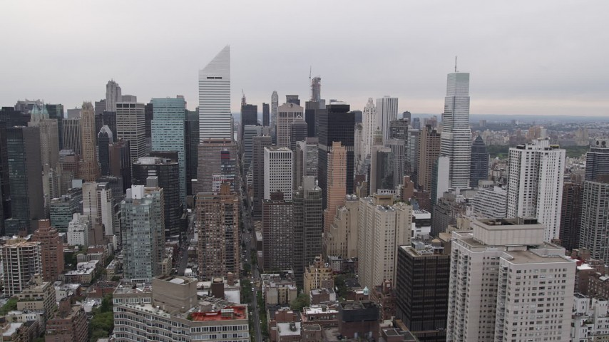 4K Aerial Video Flying by Midtown Manhattan skyscrapers, New York, New York Aerial Stock Footage | AX84_144