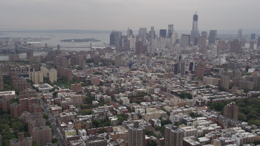 4K Aerial Video Flying by Lower Manhattan skyline, seen from East Village, New York, New York Aerial Stock Footage | AX84_150