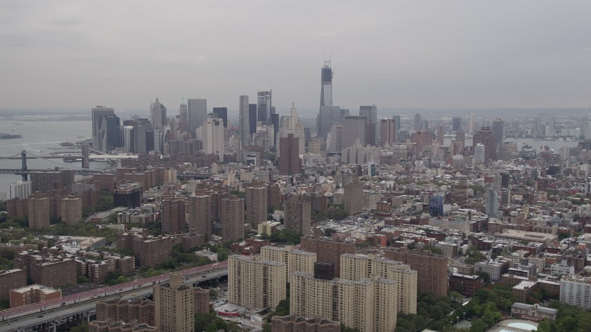 4K Aerial Video Flying by Lower Manhattan skyline, seen from Lower East Side, New York, New York Aerial Stock Footage | AX84_152