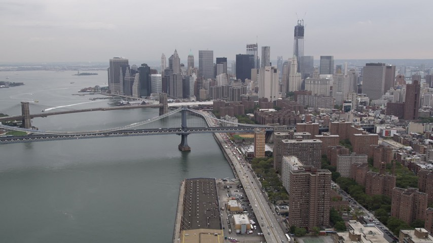 Lower Manhattan skyline, Brooklyn, Manhattan Bridges, New York, New York Aerial Stock Footage | AX84_154