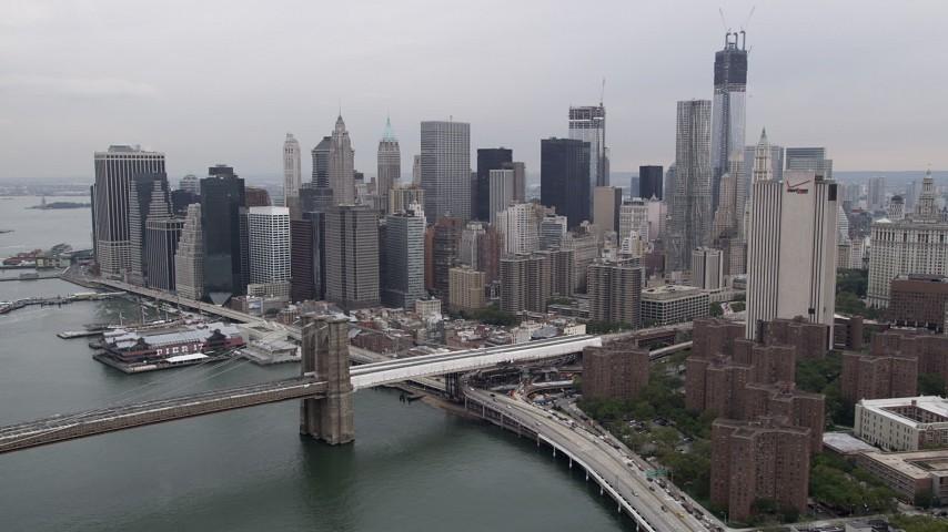 Approaching Lower Manhattan skyline, Brooklyn Bridge, New York, New York Aerial Stock Footage | AX84_156