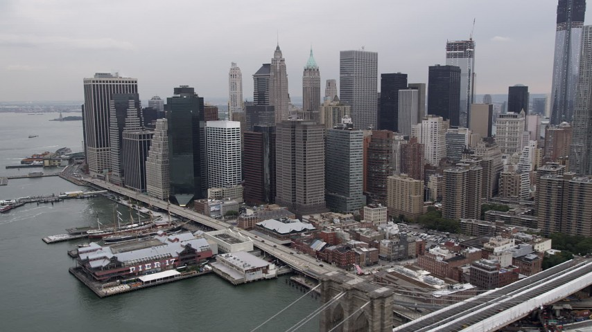 4K Aerial Video Flying by Lower Manhattan skyscrapers, piers, New York, New York Aerial Stock Footage | AX84_157