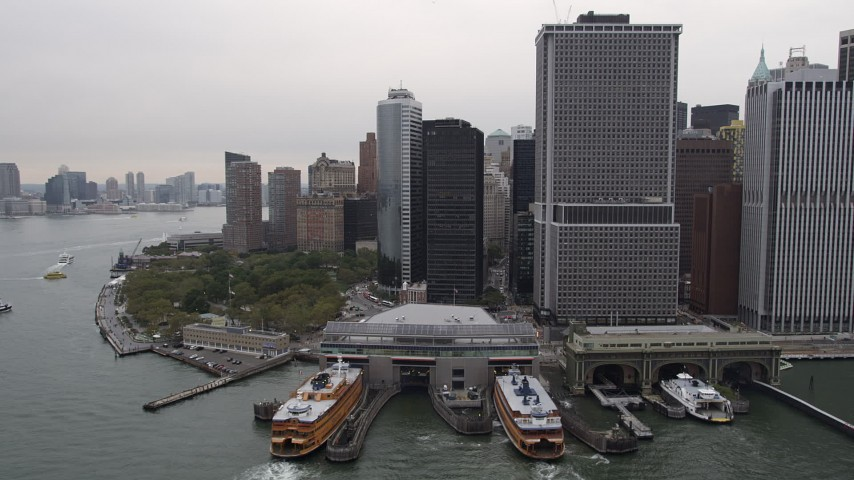 4K Aerial Video Flying by Staten Island Ferry, Lower Manhattan, New York, New York Aerial Stock Footage | AX84_160