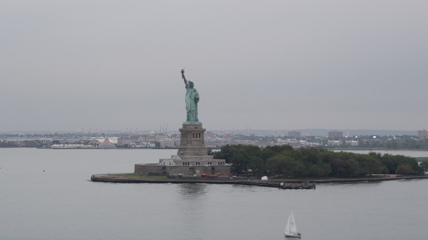 4K Aerial Video Flying by Statue of Liberty in New York Harbor, New York, New York Aerial Stock Footage | AX84_163