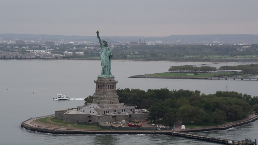 4K Aerial Video Approaching Statue of Liberty in New York Harbor, New York, New York Aerial Stock Footage | AX84_164