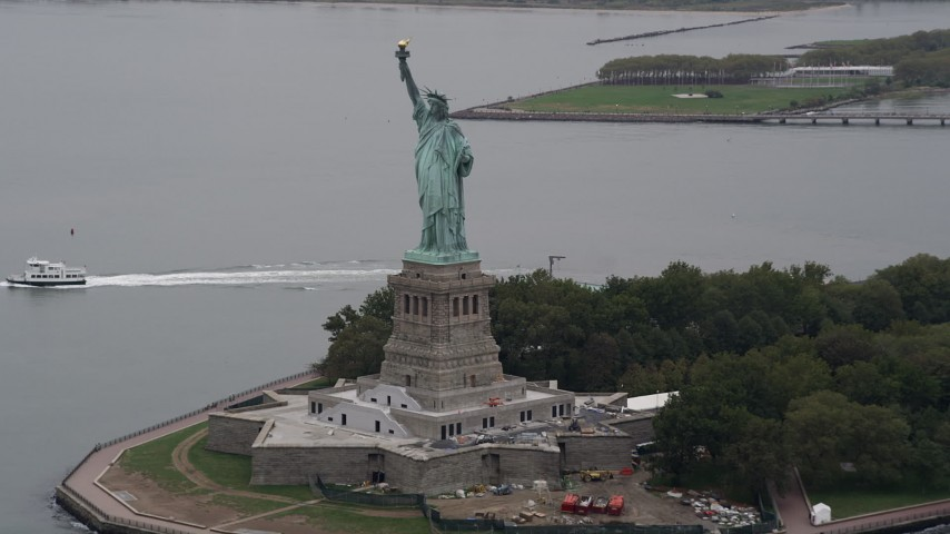4K Aerial Video of Statue of Liberty on Liberty Island, New York Harbor, New York, New York Aerial Stock Footage | AX84_165