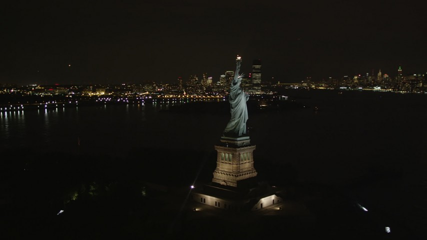 4K stock footage aerial video of flying by Statue of Liberty, New York, New York, night Aerial Stock Footage | AX85_004