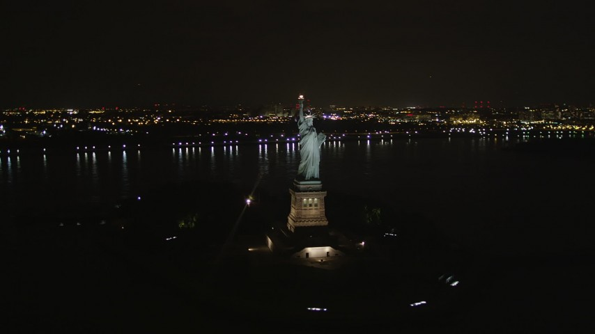 4K stock footage aerial video Orbiting the front of the Statue of Liberty, New York, New York, night Aerial Stock Footage | AX85_008