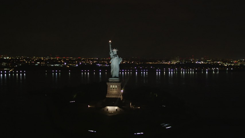 4K stock footage aerial video Flying away from the Statue of Liberty, New York, New York, night Aerial Stock Footage | AX85_011