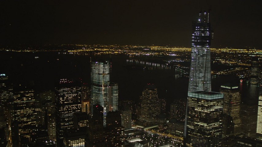 4K stock footage aerial video Flying by World Trade Center, Lower Manhattan, New York, New York, night Aerial Stock Footage | AX85_018