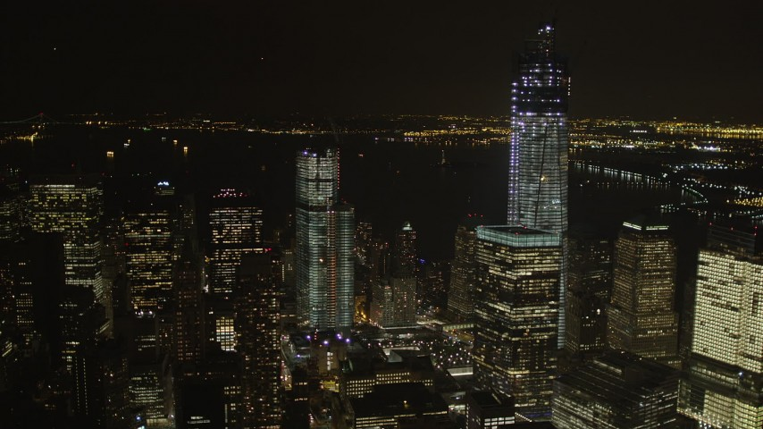 4K stock footage aerial video Flying by World Trade Center, Lower Manhattan, New York, New York, night Aerial Stock Footage | AX85_019