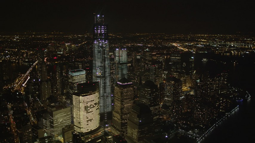 4K aerial video of Freedom Tower, World Trade Center, Lower Manhattan, New York, New York, night Aerial Stock Footage | AX85_023