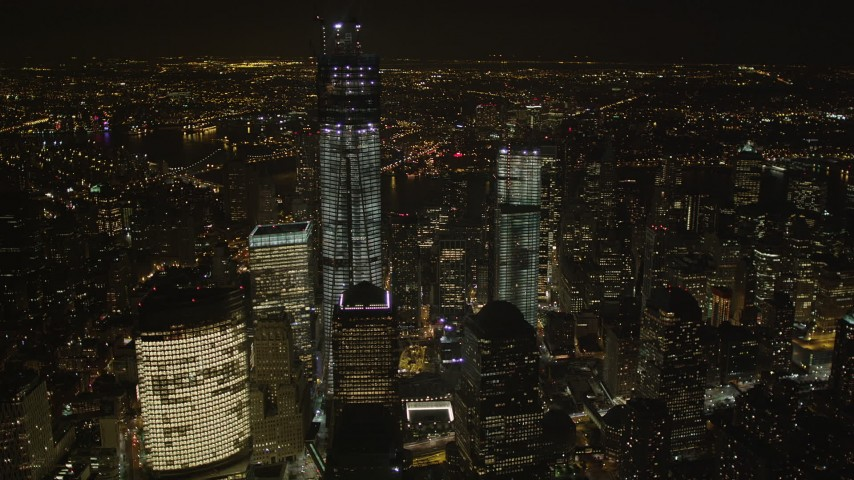 4K stock footage aerial video Flying by World Trade Center, Lower Manhattan, New York, New York, night Aerial Stock Footage | AX85_024