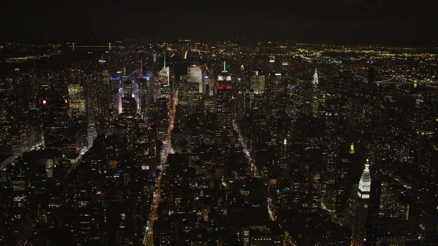 4K stock footage aerial video Approaching Midtown Manhattan, New York, New York, night Aerial Stock Footage | AX85_034