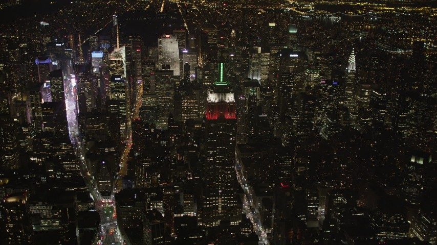 4K stock footage aerial video Approaching Empire State Building, Midtown Manhattan, New York, New York, night Aerial Stock Footage | AX85_036