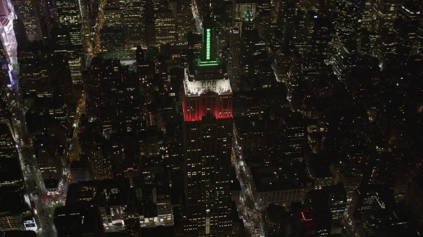 4K stock footage aerial video Tilt down on Empire State Building, Midtown Manhattan, New York, New York, night Aerial Stock Footage | AX85_037