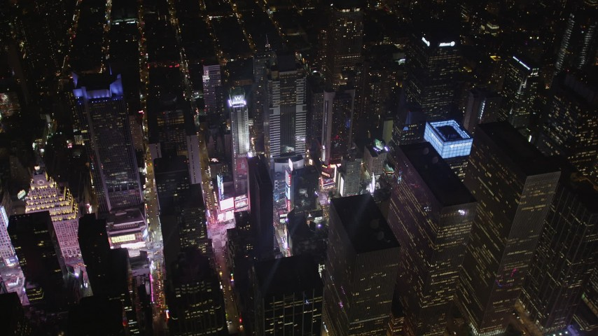 4K stock footage aerial video Times Square, skyscrapers, Midtown Manhattan, New York, New York, night Aerial Stock Footage | AX85_040